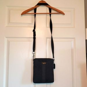 Coach crossbody. Middle part zips 2 side pockets.